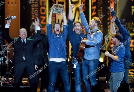 Members of German Band Revolverheld (from-r) Celebrate with Tv Presenter Stefan Raab (l) After Winning the 10th Bundesvision Song Contest Inágoettingen Germany 20 September 2014 the Competition Included Contestants From Each of the German States Germany Goettingen
