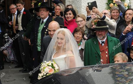 Princess Maria Theresia of Thurn and Taxis (front) is Lead Into the Church by Her Brother Albert 12th Prince of Thurn and Taxis As She Arrives For Her Wedding Ceremony at St Joseph's Church in Tuzingen Germany 13 September 2014 Germany Tutzing