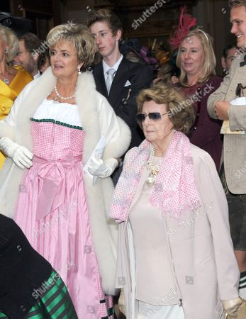 Gloria von Thurn und Taxis and Her Mother Countess Beatrix of Schoenburg-glauchau (r) Leave St Joseph's Church After the Wedding Ceremony of Princess Maria Theresia of Thurn and Taxis and Her Husband Hugo Wilson at St Joseph's Church in Tuzingen Germany 13 September 2014 Germany Tutzing