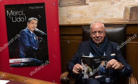 German Journalist Paul Sahner Poses with His Biography 'Merci Udo!' on Late Austrian Musician Udo Juergens in Rust Germany 02 February 2015 Germany Rust