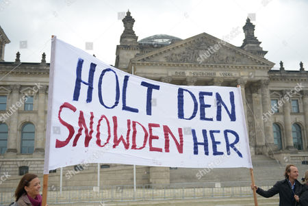 Protesters Hold a Banner in German Reading 'Bring Snowden Here' During a Protest Against the Activities of the Us National Security Agency (nsa) Outside the Reichstag in Berlin Germany 25 September 2014 Meanwhile a Swedish Charity Named Fugitive Us Intelligence Contractor Edward Snowden and British Guardian Newspaper Editor Alan Rusbridger Honorary Co-winners of the 2014 Right Livelihood Award For 'Acts of Civil Disobedience ' Snowden who Currently Has Asylum in Russia is Wanted by the Us Government on Espionage Charges For Exposing Extensive Telephone and Internet Data-collection Programmes Used by the Us National Security Agency (nsa) Germany Berlin