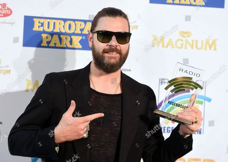 Irish Musician Rea Garvey Poses with His Charity Award 2014 Prior to the Radio Regenbogen (rainbow) Awards Ceremony at the Europa-park in Rust Germany 24 April 2015 Germany Rust