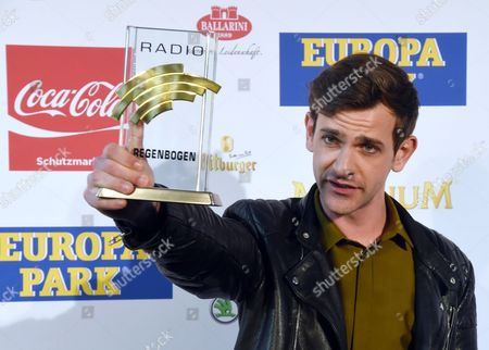 Stock Image of Australian Singer Josef Salvat Poses with His Newcomer International Award 2014 Prior to the Radio Regenbogen (rainbow) Awards Ceremony at the Europa-park in Rust Germany 24 April 2015 Germany Rust