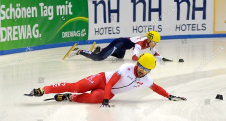 Victor an of Russia (back) and Charles Hamelin of Canada Fall During the Shorttrack World Cup at the Energieverbund Arena in Dresden Germany 07 February 2015 Germany Dresden