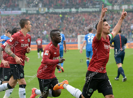 Hanover's Lars Stindl (r) Celebrates His 1-1 Goal with Teammates Joselu (l) and Didier Ya Konan During the German Bundesliga Soccer Match Between Hannover 96 and 1899 Hoffenheim at the Hdi-arena in Hanover ágermany 25 April 2015 Germany Hanover