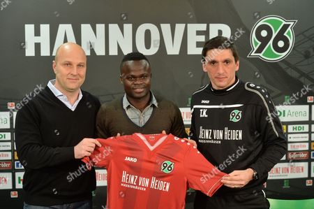 Stock Picture of Didier Ya Konan Stands Between Manager Dirk Dufner (l) and Coach Tayfun Korkut (r) During a Press Conference with German Bundesliga Soccer Team Hannover 96 in Hanover Germany 27 January 2014 Ya Konan is Returning to Hanover 96 Germany Hanover