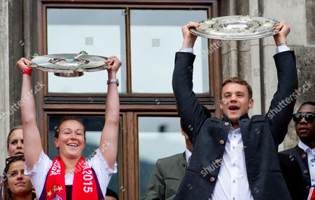 Tinja-riikka Korpela (l) of Bayern Munich's Women Team and Manuel Neuer From Fcábayern Munich Men's Team Hold Up the Men's and Women's Championship Shields During a Joint Celebration on the Balcony of the Town Hall Inámunich Germany 24 May 2015 Germany Munich