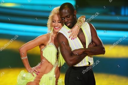 A Picture Made Available on 25 April 2015 Shows Ghanaian-born German Former Soccer Player Hans Sarpei (r) and Austrian Professional Dancer Kathrin Menzinger Perform During the Rtl Television Program 'Let's Dance' in Cologne Germany 24 April 2015 Germany Cologne