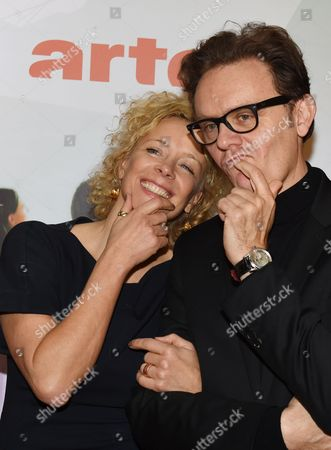 Stock Picture of German Actress Katja Riemann (l) and French Director Gabriel Le Bomin Pose During a Press Conference of Franco-german Tvánetwork Arte For the Presentation of the Movies 'Das Gespaltene Dorf' (lit 'The Divided Village') and 'Tag Der Wahrheit' (lit 'Day of the Truth') Which Will Be Aired on 08 and 09 January in Berlin Germany 05 December 2014 Germany Berlin