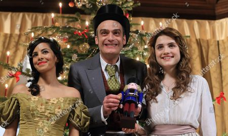 Stock Photo of From (l-r) Actress Collien Fernandes Elm Swiss Actor Anatole Taubman and Mala Emde Pose For the Media While Filming the Tv Movie 'The Nutcracker and the Mouse King' in Quedlinburg (saxony-anhalt) Germany 17 March 2015 Germany Quedlinburg