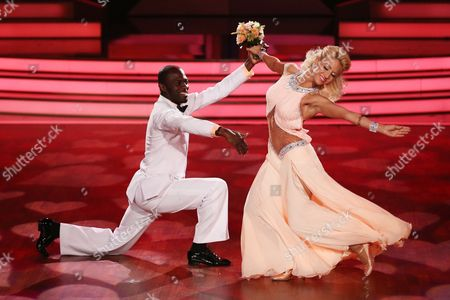 A Picture Made Available on 21 March 2015 Shows Ghanaian-german Ex-footballer Hans Sarpei (l) and Dancer Kathrin Menzinger Performing During the Rtl Television Program 'Let's Dance' in Cologne Germany 20 March 2015 Germany Cologne