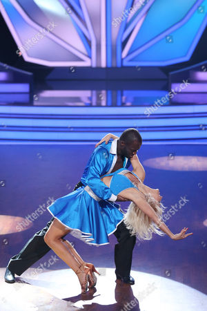 A Picture Made Available on 14 March 2015 Shows Ghanaian-german Ex-footballer Hans Sarpei (back) and Austrian Dancer Kathrin Menzinger Performing During the Rtl Television Program 'Let's Dance' in Cologne Germany 13 March 2015 Germany Cologne