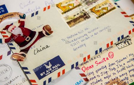 a close up showing christmas wish lists from abroad which arrived at the christmas post - Christmas Lists 2014