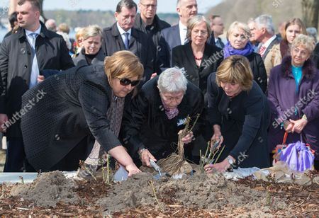 (l-r) Anna Komorowska Wife of the Polish President Annette Chalut President of the International Ravensbrueck Committee and Survivor of the Ravensbreuck Nazi Death Camp and Daniela Schadt Life Partner of the German President Plant Roses at the Memorial Event For the 70th Anniversary of the Camp's Liberation at the Memorial Site at the Former Womens Nazi Death Camp of Ravensbrueck in Fuerstenberg Germany 19 April 2015 Around 160 Survivors From Around the World Have Returned to Brandenburg For the Anniversary of the Liberation Germany Fuerstenberg