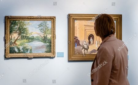 Stock Picture of Curator of the Exhibition Tatjana Duebbel Looks at Pictures Painted by Winston Churchhill 'The Bridge Near Aix-en-provence' (l) and 'City Gate in Marrakech' in Luebeck Germany 11 November 2016 the Special Exhibition 'Winston Churchill Writings Speeches Pictures' Can Be Seen at Gunter-grass-house From 12 November 2016 to 12 February 2017 Germany L³beck
