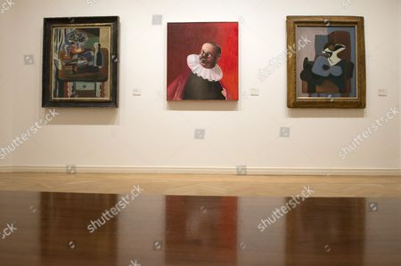 The Painting 'Figure with Red Cape' (c) by Us Painter George Condo is on Display Between the Two Artworks 'Still Life with Blue Guitar' (l) and 'Female Nude' (r) by Spanish Artist Picasso at the Scharf Gerstenberg Collection Art Museum in Charlottenburg Berlin Germany 18 November 2016 the Museum Berggruen That is Part of the Scharf Gerstenberg Collection Presents an Exhibition on Condo Entitled 'George Condo Confrontation' Which Opens to the Public From 19 November 2016 on Germany Berlin