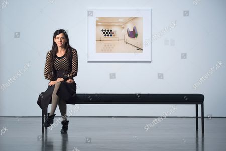 Us Artist Taryn Simon Sits in Front of the Photo 'The Central Intelligence Agency (cia) Art in the Building at the Cia Headquarters' in the Exhibition 'A Soldier is Taught to Bayonet the Enemy and not Some Undefined Abstraction'áby Us Artist Taryn Simon in the Albertinum in Dresden ágermany 26 October 2016 the Exhibition Takes Place From 27 October 2016 to 15 January 2017 Germany Dresden