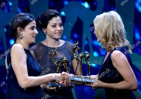 Syrian Swimmers Yusra Mardini (c) and Sarah Mardini (l) Receive Their Award in the 'Silent Heroes; Category at the 68th Bambi Award Media Awards Ceremony in Berlin Germany 17 November 2016 the Awards Are the Oldest Media Awards in Germany and Are Held Annually to Recognise Excellence in International Media and Television Germany Berlin