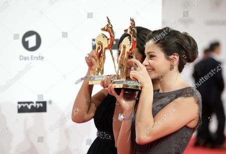 Syrian Swimmers Yusra Mardini (r) and Her Sister Sarah Mardini (l) Present Their Award in the 'Silent Heroes; Category at the 68th Bambi Award Media Awards Ceremony in Berlin Germany 17 November 2016 the Awards Are the Oldest Media Awards in Germany and Are Held Annually to Recognise Excellence in International Media and Television Germany Berlin