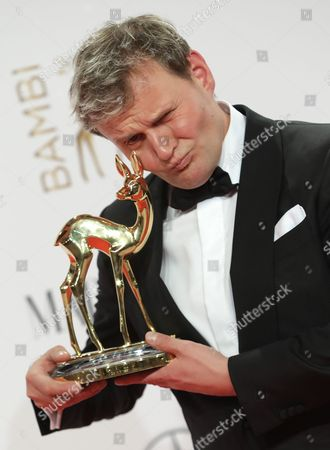 German Actor Devid Striesow Hold Up His 'German Actor' Award at the 68th Bambi Award Media Awards Ceremony in Berlin Germany 17 November 2016 the Awards Are the Oldest Media Awards in Germany and Are Held Annually to Recognise Excellence in International Media and Television Epa/joerg Carstensen Germany Berlin
