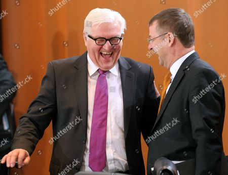 German Foreign Minister Frank-walter Steinmeier (l) Speaking with the Head of the Federal President's Office State Secretary David Gill at the Start of the Cabinet Session at the Federal Chancellery in Berlin Germany 30 November 2016 Germany Berlin