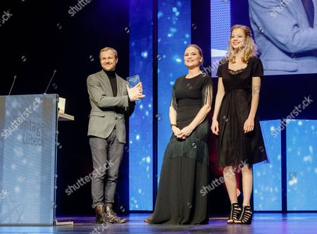 Swedish Actress Malin Levanon (c) and German Actress Emma Bading (r) Present the 'Children's and Youth Film Prize' to Latvian Director Renars Vimba (l) For His Film 'Mellow Mud' in Luebeck Germany 05 November 2016 During the 58th Nordic Film Days Germany Luebeck