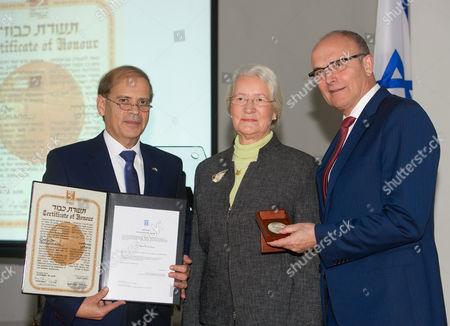 The Israeli Ambassador Yakov Hadas-handelsman (l) and Prime Minister of Mecklenburg-western Pomerania Erwin Sellering (r) Award Christa Heptner (m) Daughter of Mathilde Boeckelmann Posthumously the Title 'Gerechte Unter Den V÷lkern' (lit 'Just Among the Peoples') For Her Mother at the Auditorium of the Friedrich-ludwig-jahn-gymnasium in Greifswald Germany 23 November 2016 Mathilde Boeckelmann Saved the Persecuted Jewish Woman Mirjam Fernbach by Hiding Her at Her Farm in the Pomeraninan Pustow in 1945 Germany Greifswald