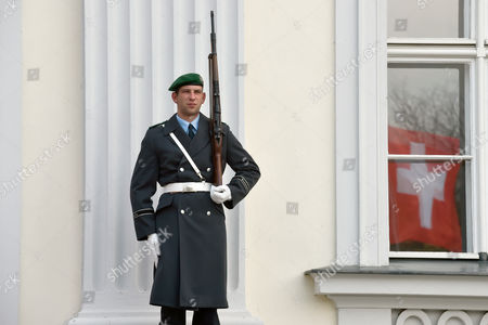 A Soldier of the Guard Battalion Stands in Front of the Palace Bellevue where a Swiss Flag is Reflected in the Window in Berlin Germany 02 November 2016 Swiss President Johann Niklaus Schneider-ammann is on an Official Visit to Germany Germany Berlin