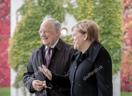 German Chancellor Angela Merkel (r) Welcomes Swiss President Johann Niklaus Schneider-ammann (l) at the Chancellery in Berlin ágermany 02 November 2016 Schneider-ammann and Merkel Are Meeting For Bilateral Talks Germany Berlin