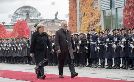 German Chancellor Angela Merkel (l) Welcomes Swiss President Johann Niklaus Schneider-ammann (r) with Military Honors Outside the Chancellery in Berlin ágermany 02 November 2016 Schneider-ammann and Merkel Are Meeting For Bilateral Talks Germany Berlin