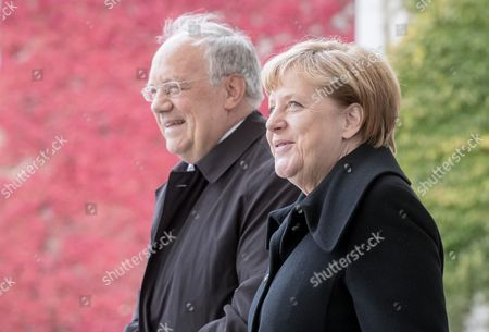 German Chancellor Angela Merkel (r) Welcomes Swiss President Johann Niklaus Schneider-ammann (l) Outside the Chancellery in Berlin ágermany 02 November 2016 Schneider-ammann and Merkel Are Meeting For Bilateral Talks Germany Berlin