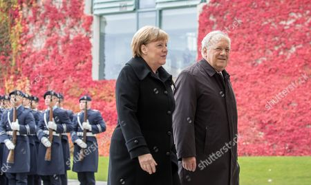 German Chancellor Angela Merkel (l) Welcomes Swiss President Johann Niklaus Schneider-ammann (r) with Military Honors Outside the Chancellery in Berlin ágermany 02 November 2016 Schneider-ammann and Merkel Are Meeting For Bilateral Talks Epa/michaelákappeler Germany Berlin