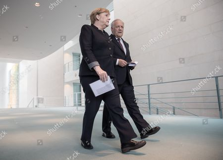 German Chancellor Angela Merkel (l) and Swiss President Johann Niklaus Schneider-ammann (r) Attend For a Press Conference After Bilateral Talks in Berlin ágermany 02 November 2016 Germany Berlin