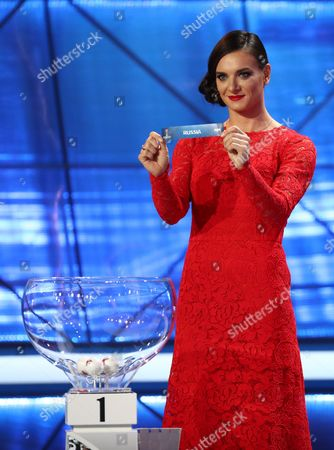 Two-time Olympic Gold Medalist Yelena Isinbayeva Presents the Ticket of Russia During the Draw of Fifa Confederations Cup 2017 in Kazan Russia 26 November 2016 Epa/christian Charisius Russia Kazan