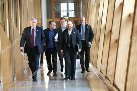 Patrick Harvie, Co-convener of the Scottish Greens, leads Scottish Green MSPs to the Debating Chamber: John Finnie, Andy Wightman, Ross Greer, Patrick Harvie and Mark Ruskell