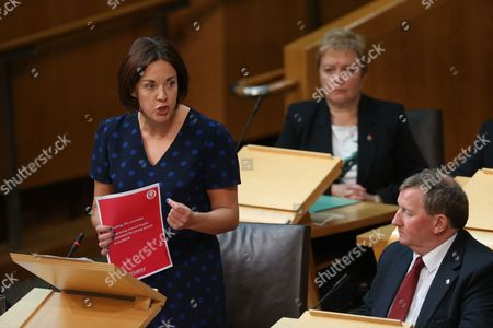 Stock Picture of Kezia Dugdale, Leader of the Scottish Labour Party, holds a Scottish Labour Party document on improving mental treatment for young people in Scotland, while watched by Rhoda Grant and Alex Rowley, Deputy Leader of the Scottish Labour Party