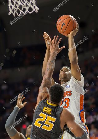 Justin Leon, Russell Woods Florida forward Justin Leon, right, shoots over Missouri forward Russell Woods (25) during the second half of an NCAA college basketball game in Gainesville, Fla., . Florida won 93-54