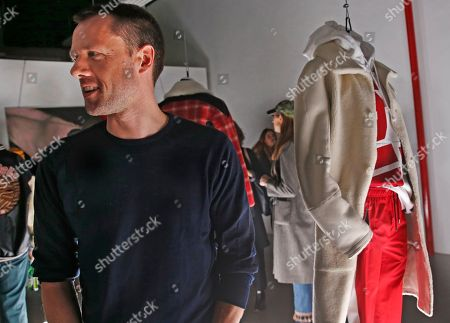 Designer Tim Coppens greets guests at the presentation of his Tim Coppens capsule collection and book launch during Men's Fashion Week, in New York