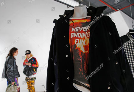 Fashions are displayed hanging from the ceiling during the presentation of Tim Coppens' capsule collection and book launch at Men's Fashion Week, in New York