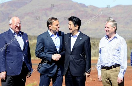 Stock Image of (l-r) Rio Tinto Chief Executive Officer Sam Walsh Australian Prime Minister Tony Abbott Japanese Premier Shinzo Abe and the Prime Minister of Western Australia Colin Barnett Arrive For a Tour of the Rio Tinto West Angelas Iron Ore Mine in the Pilbara West Australia July 9 2014 Australia Canberra