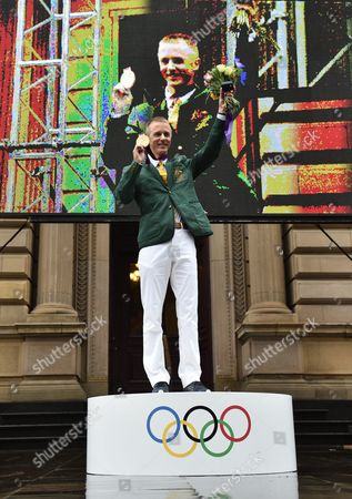 Australian Race Walker Jared Tallent Holds His Belatedly Presented Gold Medal For the 50km Walk at the 2012 London Olympics on the Steps of the Treasury in Melbourne Victoria Australia 17 June 2016 the 50km Walker Had Finally His 2012 Olympic Silver Medal Replaced by Gold at a Ceremony at the Treasury Building in Melbourne at Midday After Russian Athlete Sergey Kirdyapkin was Revealed As a Drug Cheat Earlier This Year and Stripped of His Title Australia Melbourne