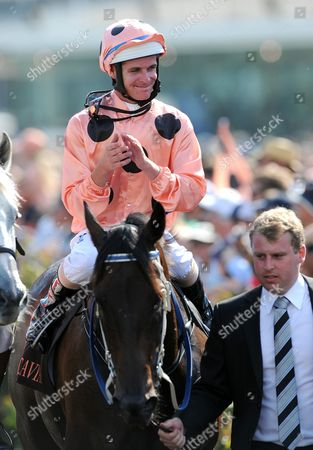 Stock Picture of Jockey Luke Nolen Rides Race Horse Black Caviar Back to the Dis-mounting Area After Winning the A$500 000 Group 1 Race at Flemington Race Track in Melbourne Feb 16 2013 the Win by Black Caviar is the First Since Winning the Diamond Jubilee at Royal Ascot in England and Her 23rd Straight Win Australia Melbourne