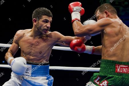 Australian Featherweight Boxer Billy Dib (l) Lands a Left Hook on Jorge Lacierva of Mexico For the Ibf (international Boxing Federation) World Featherweight Title at the State Sports Centre in Sydney Australia on 29 July 2011 Dib 25 From the Western Suburbs of Sydney Beat Jorge Lacierva 33 of Mexico in a Unanimous Points Decision Australia Sydney