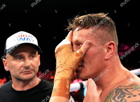 Australia's Danny Green Wipes His Face As Trainer Angelo Hyder (left) Looks on After His Loss to Antonio Tarver of America During Their Ibo Cruiserweight Title Fight in Sydney Australia on Wednesday July 20 2011 Tarver Defeated Green to Become the New Ibo Cruiserweight Champion Australia Sydney
