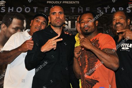 Stock Photo of (l-r) Tony Mundine (father of Anthony Mundine) Australian Boxer Anthony Mundine Us Boxer 'Sugar' Shane Mosley and Jack Mosley (farther of Shane Mosley) Pose For a Photograph Following a Press Conference in Sydney Australia 09 October 2013 Anthony Mundine and Shane Mosley Will Fight Their Light Middleweight Bout in Sydney on 23 October Australia Sydney