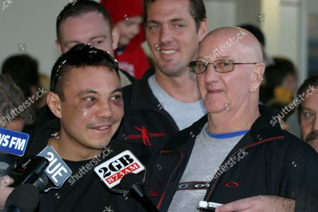 Russian Born Boxer Kostya Tszyu (l) Talks to the Media with Trainer Johnny Lewis After They Arrived at Sydney Airport Wednesday 08 June 2005 Tszyu Lost the Ibf World Light Welterweight Title to England's Ricky Hatton in Manchester on Sunday Tszyu Also Refuted Claims From a Russian Newspaper That They Had Split After the Fight Australia Sydney