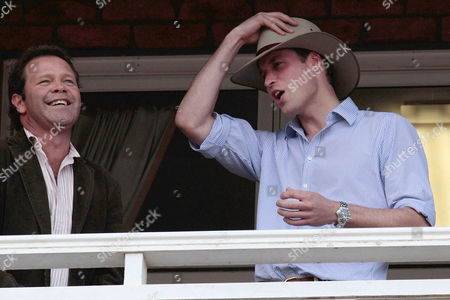 Prince William of Wales (r) Wears an Akubra Hat an Australian Brand of Bush Hat After Maltese-australian and Aboriginal Country Musician Troy Cassar-daley (l) Presented It to Him As a Gift at the Toowoomba Show Grounds Community Concert Toowomba Queensland Australia on 20 March 2011 the Prince is Four Days Into His Five Day Tour to Disaster Affected Area of New Zealand Queensland and Victoria Australia Brisbane