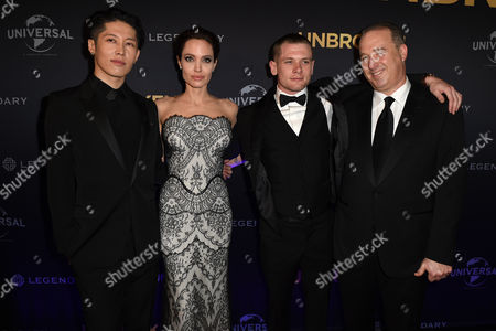 (l-r) Japanese Actor Miyavi Us Actress-director Angelina Jolie British Actor Jack O'connell and Producer Matthew Baer Pose at the World Premiere of 'Unbroken' in Sydney Australia 17 November 2014 Unbroken is the Second Film Which Jolie Has Directed Australia Sydney