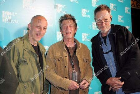 Directors and Festival Judges Oliver Hirschbiegel (l) and Rolf De Heer (r) Pose with British Actor John Hurt For a Photograph at the Premiere of Wake in Fright During the Sydney Film Festival in Sydney Australia 13 June 2009 the 56th Sydney Film Festival Runs From 03 to 14 June 2009 Australia Sydney