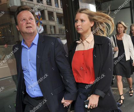 Madeleine Pulver (c) Departs with Her Father Bill Pulver (l) Following the Sentencing of Paul Peters at the Downing Centre District Court in Sydney Australia 20 November 2012 Former Banker Paul Peters the Man who Strapped a Hoax Collar Bomb Around the Neck of Madeleine Pulver in Her Mosman Home in 2011 Received a Maximum Sentence of 13 Years and Six Months Australia Sydney